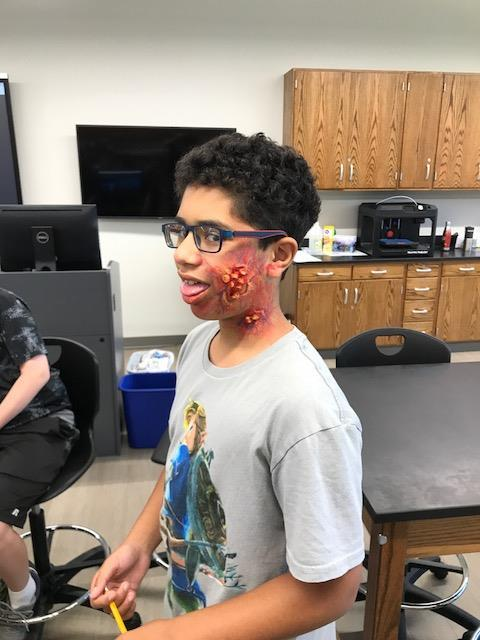 "Student with ""disaster"" makeup on cheek"