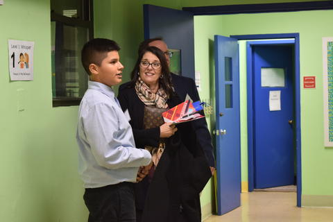 S2 Student showing Supporters around the school during Back to School Night