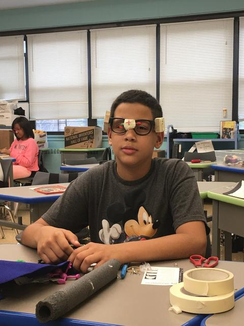 A student wears a pair of futuristic glasses