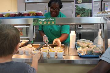 Child Nutrition staff serves lunch at Sudduth Elementary