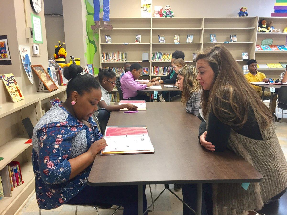 West Elementary School students discuss leader notebooks with community members