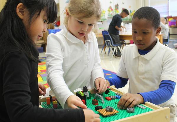 Kindergarten students in a classroom working together