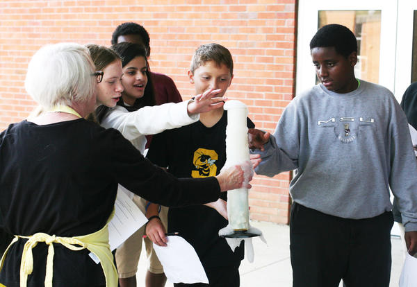 Middle school students participate in a science experiment