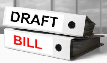 "Two folders with the words ""Draft"" and ""Bill"" on their spines."
