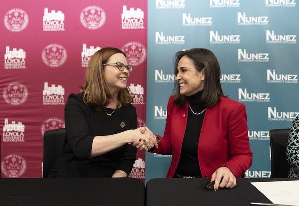 Loyola President Tetlow and Nunez Chancellor Tinney solidify the agreement with a handshake