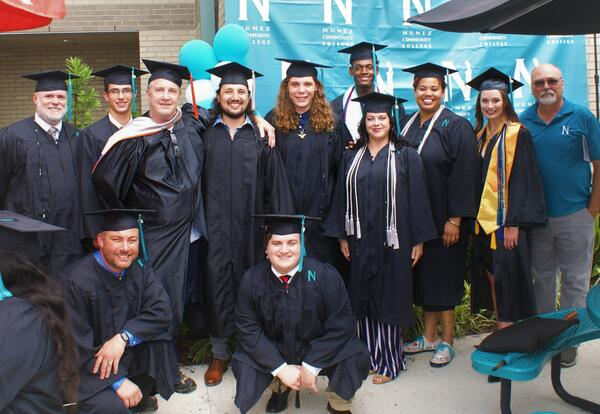 Pictured are graduates and instructors from Nunez's Aerospace Manufacturing Technology Program.