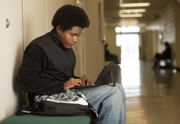 Student studying on his laptop