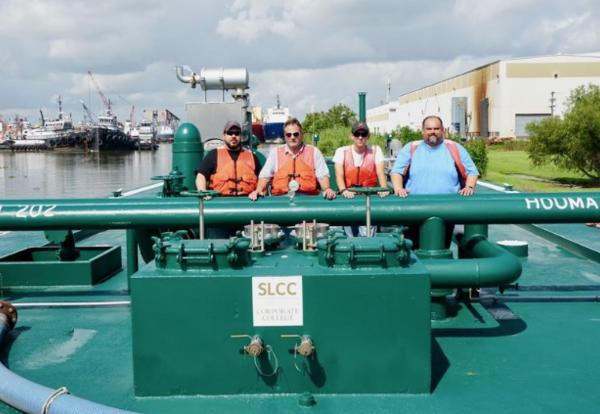 From left: Todd Boudreaux, safety instructor; Duffy Guidry, maritime instructor; Raymond Callais, tankerman student; Mark Courteaux, tankerman instructor and Cenac boat captain.