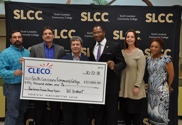 CLECO representatives presented SLCC officials with a check for $50,000.
