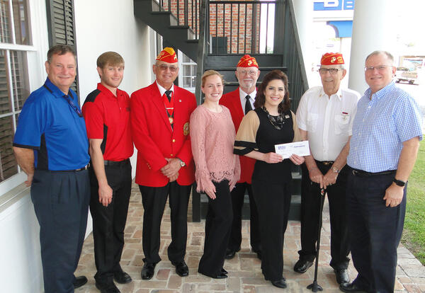 LCC's Lana Fontenot, third from right, receives an annual scholarship check from the Lt. Dronet Marine Corps League and Gulf Coast Bank.