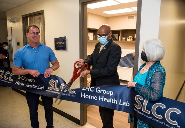 cutting the ribbon on the new home health lab
