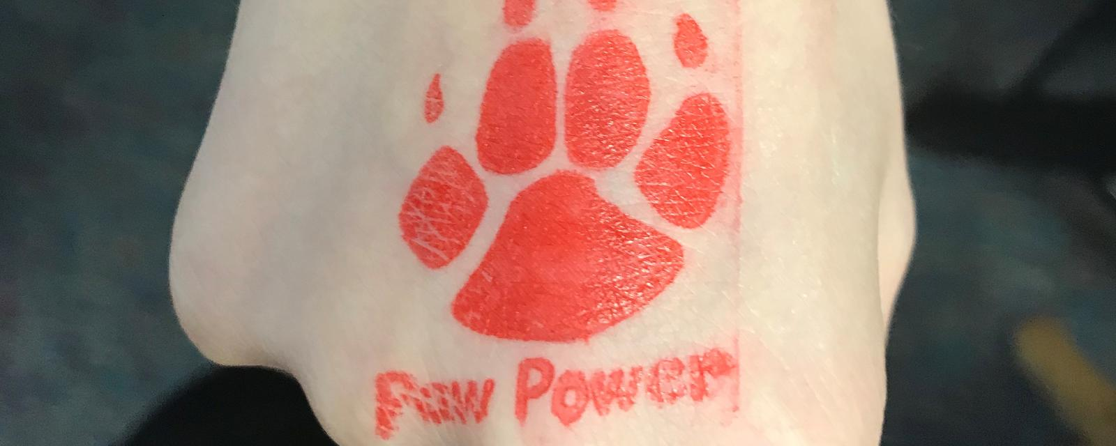 "Red paw with words ""Paw Power"""