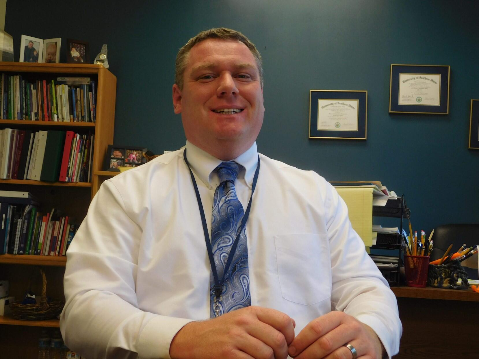 Photo of superintendent at desk