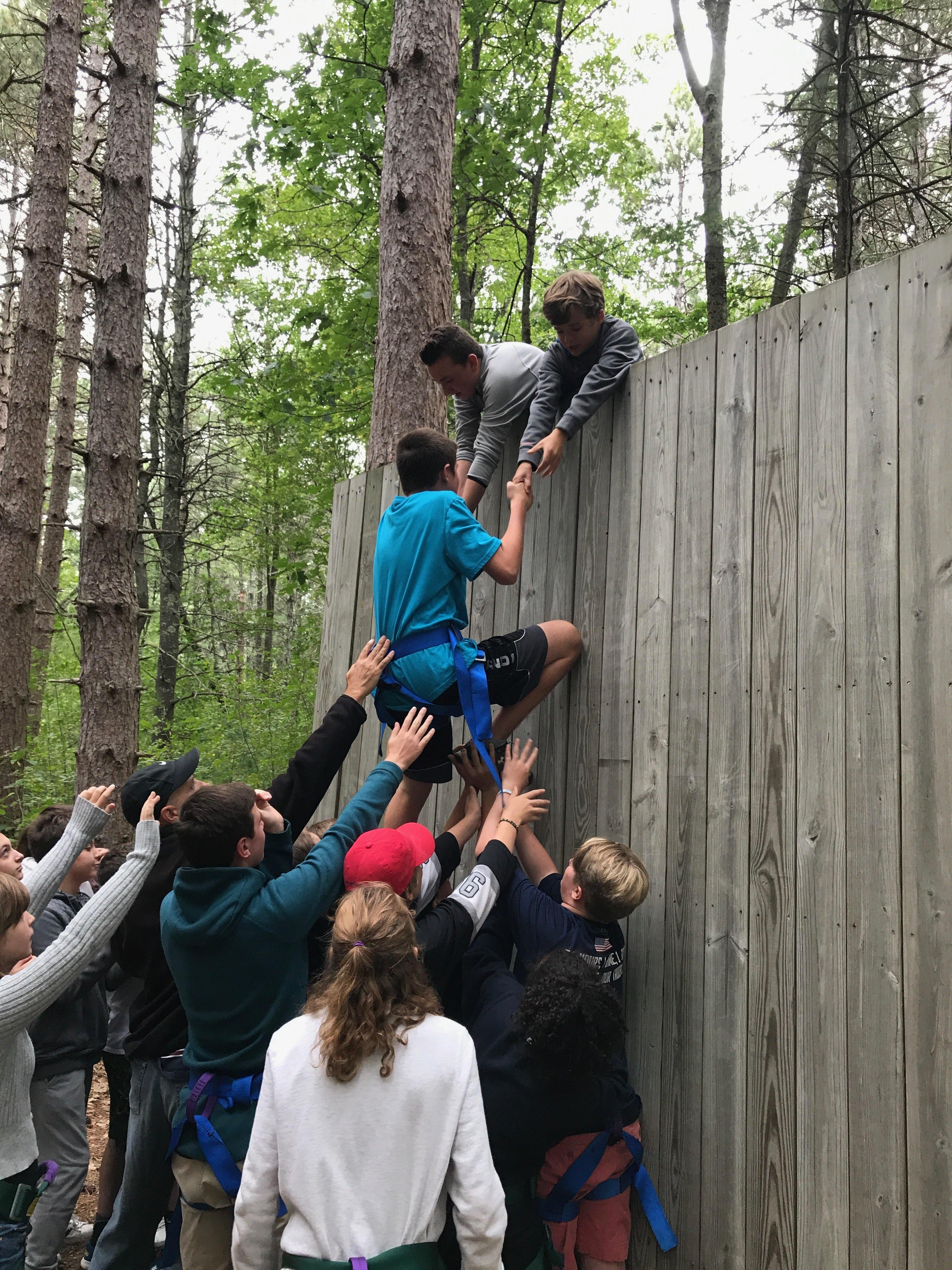 Student climbing the wall in challenge course