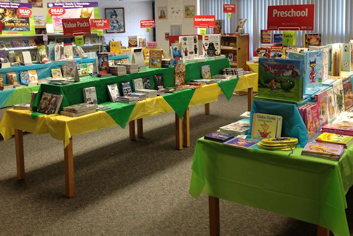 Book fair set up in displays with books on tables.