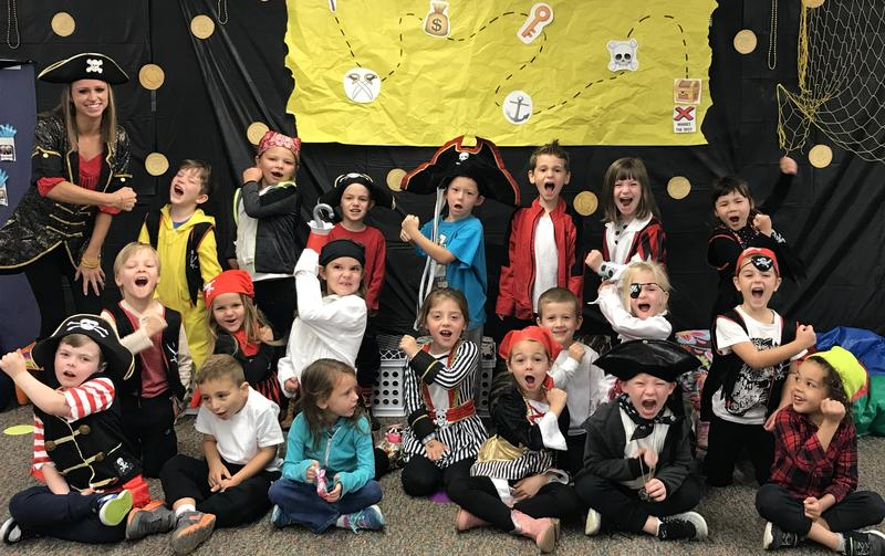 Student group photo dressed as pirates