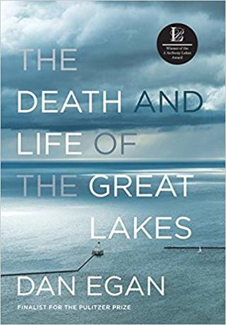 Book cover of The Death and Life of the Great Lakes by Dan Egan. Image of clouds over vast blue water with a lighthouse/ breakwater in distance.