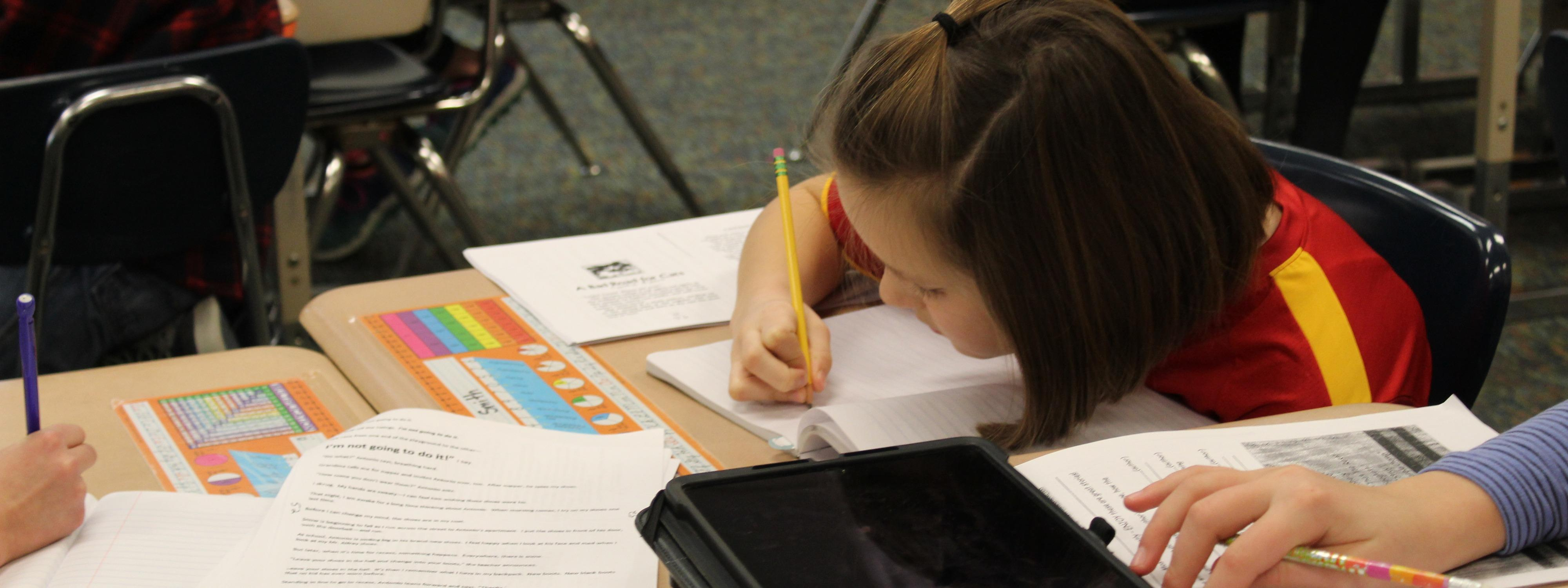 student working on math with an iPad
