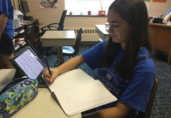 Student using technology in Honors Math