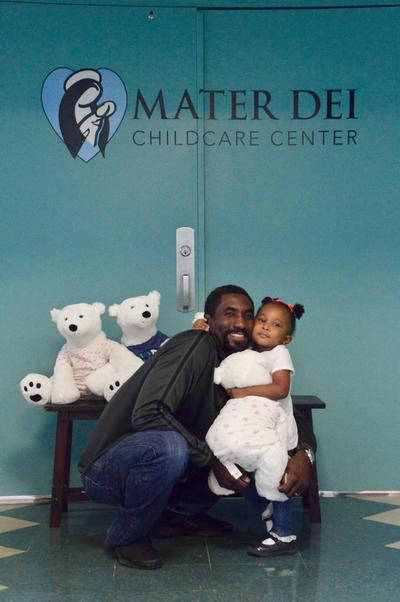 Dad with daughter at doors to Childcare Center