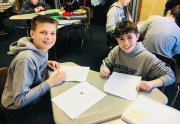 students working in pairs