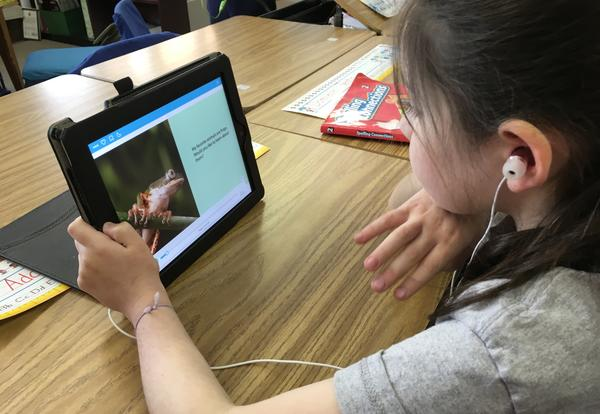 student reading on an iPad