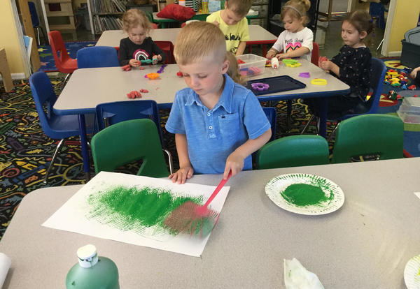 students painting with fly swatters