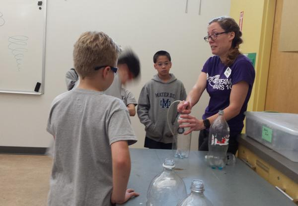 students doing a science experiment