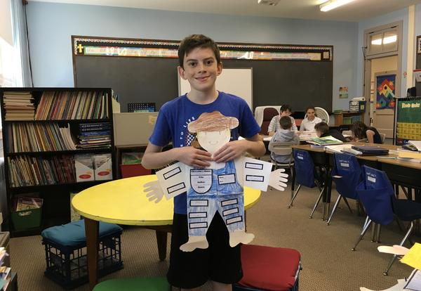 student holding person book report