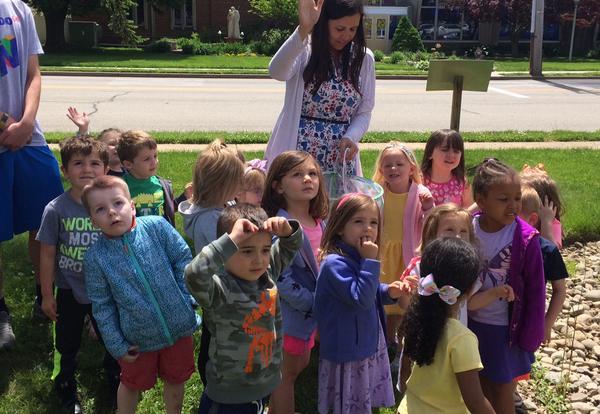 students releasing butterflies