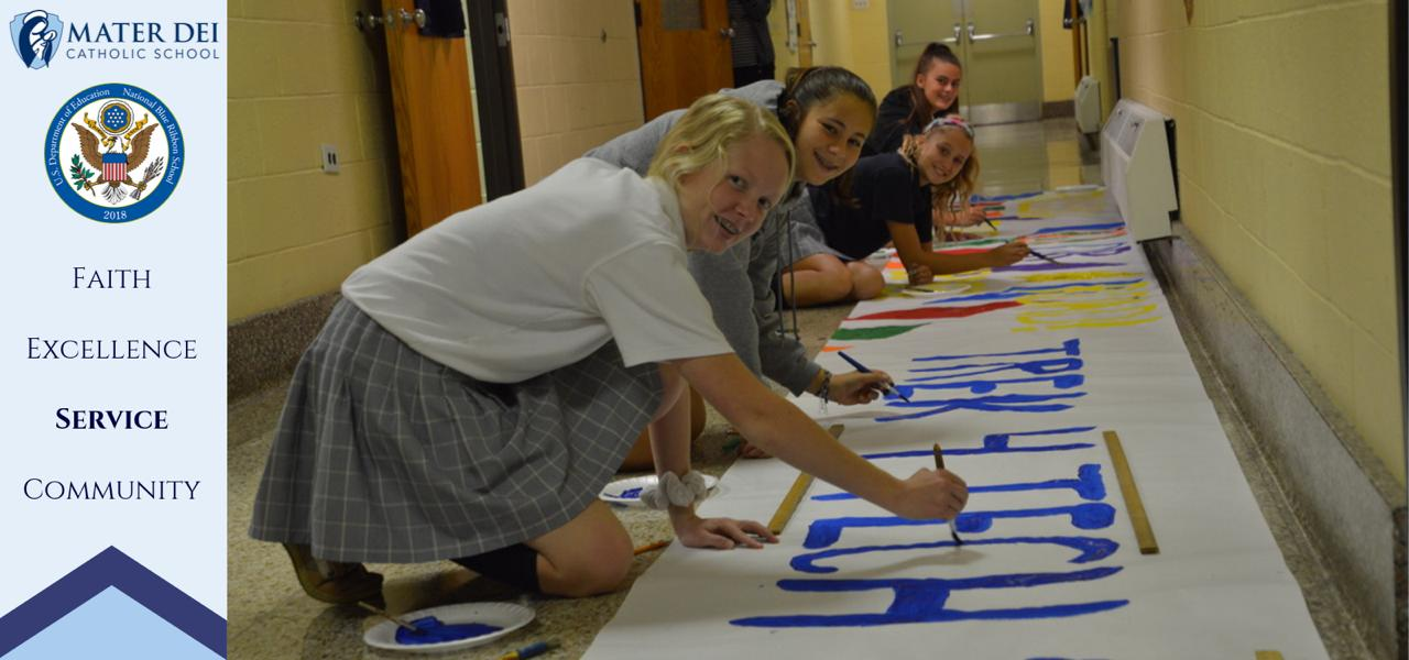 Students painting banners