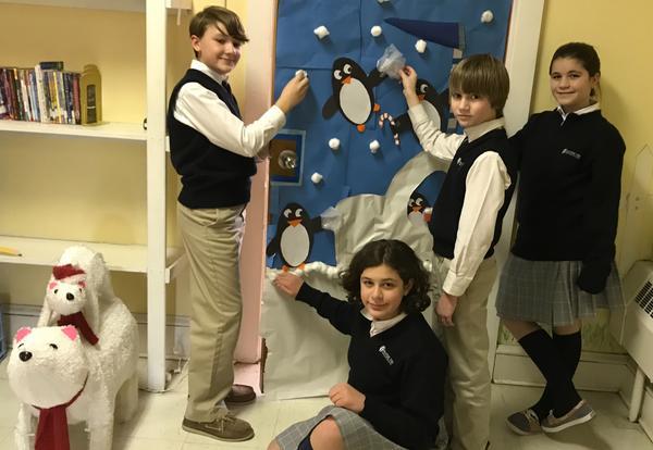 students decorating a door