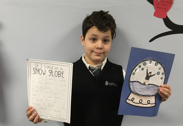 student showing writing piece