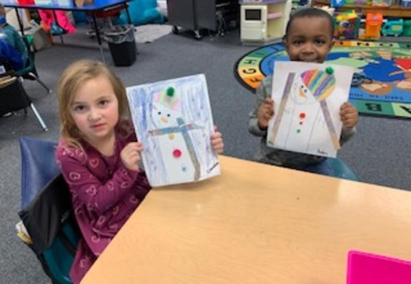 students displaying snowmen