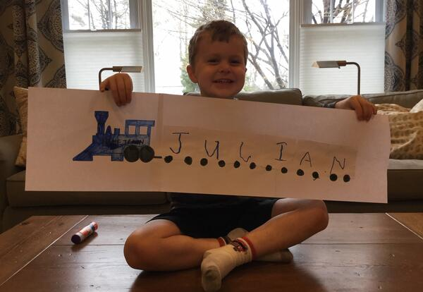 student showing his name train
