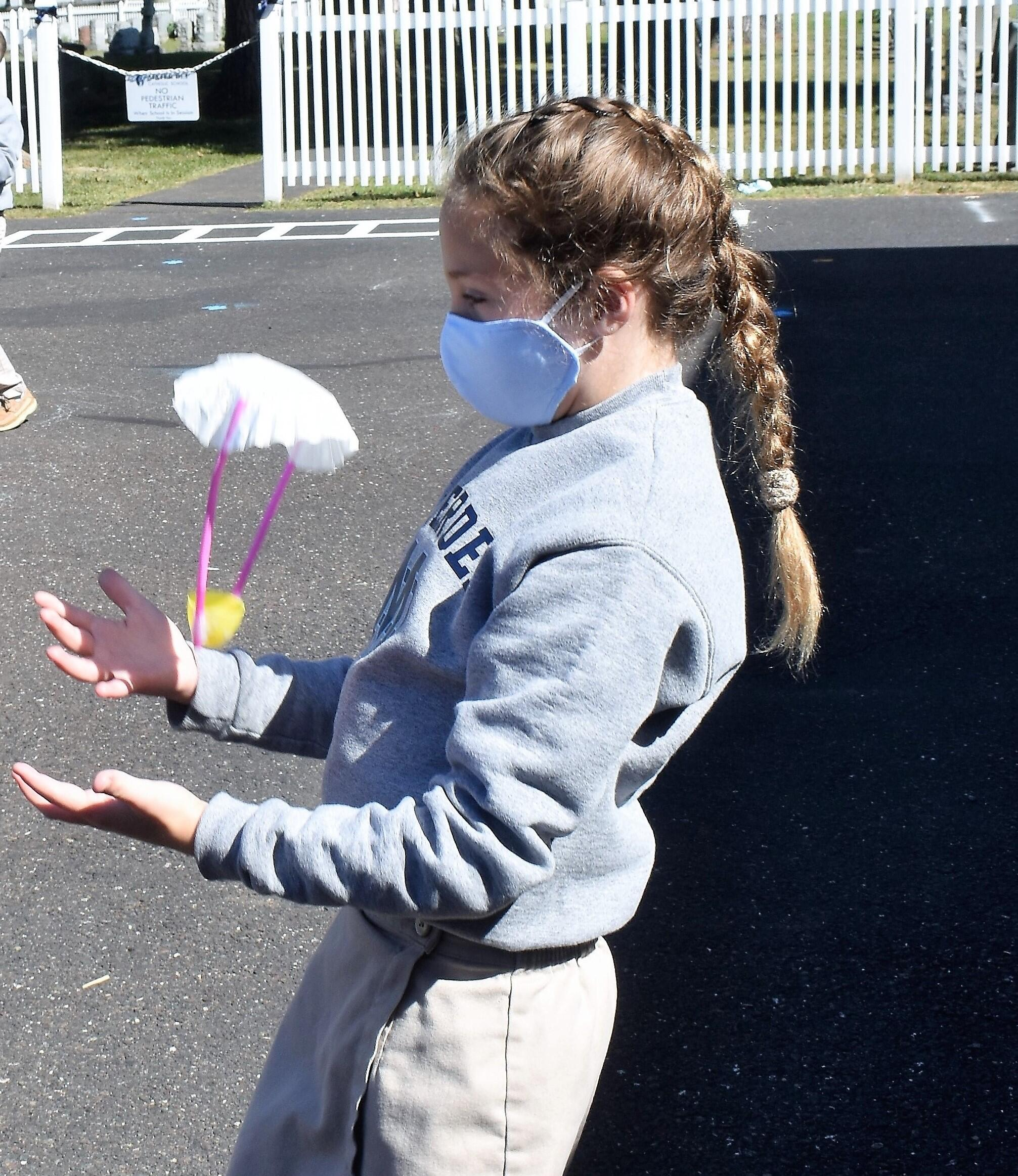 Second graders build heart mountains to withstand a breath wind.