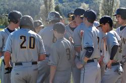 Baseball players in a huddle after the game.