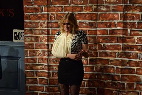 Student with arm in a cloth sling looks sad