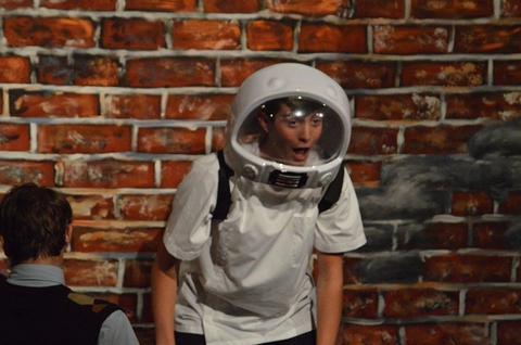 Student with space helmet, looking surprised