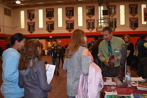College rep speaks with students