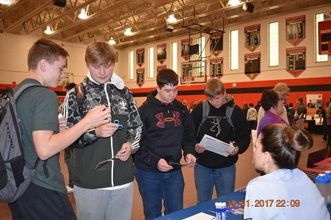 Students looking at materials from colleges
