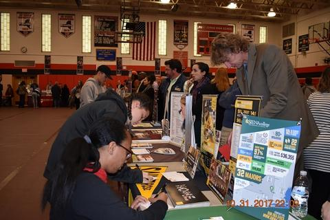 Students filling out info at college tables