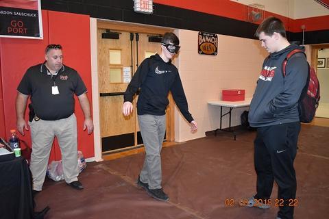 Blindfolded student walks a line
