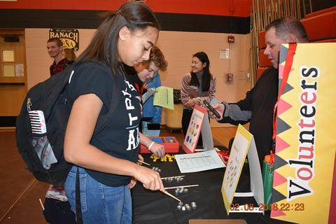 Student looks at volunteering information