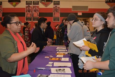 Fair participant talking with students