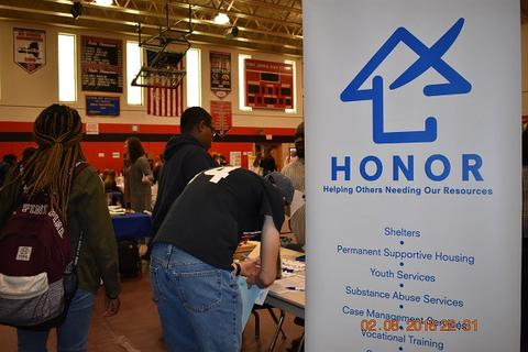 """Sign says """"HONOR - Helping Others Needing Our Resources"""""""