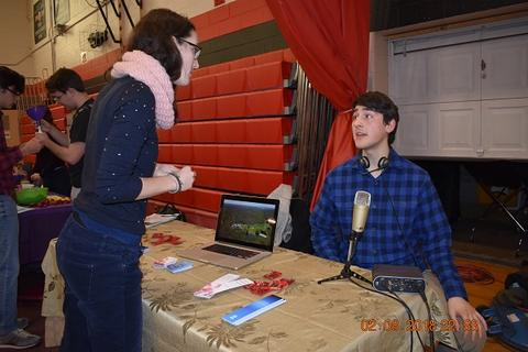 Woman speaking with student broadcaster