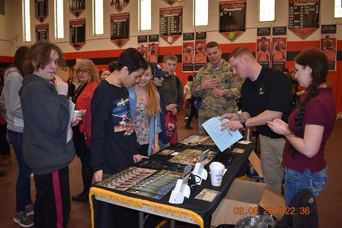 Students speak with military recruiters