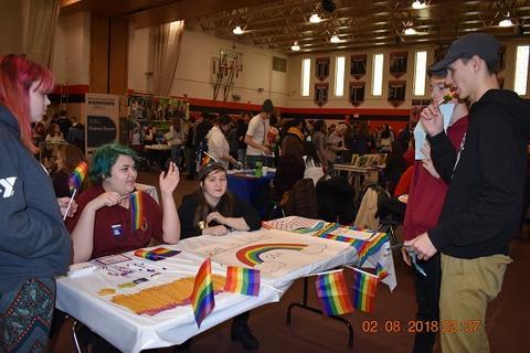 Students at LGBTQA booth