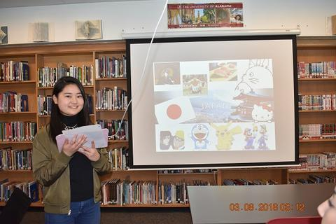 Student explaining Japanese culture, while holding cards